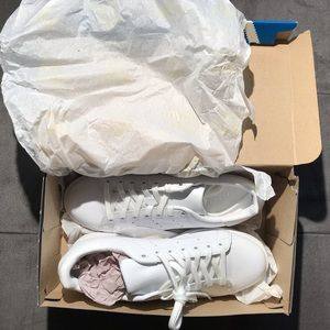 All white Stan Smith sneakers